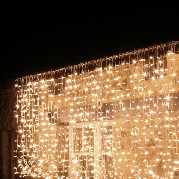 warm white hire outdoor curtain lights on green cable