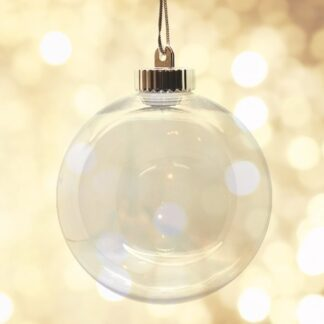 150mm clear bauble against dappled light background