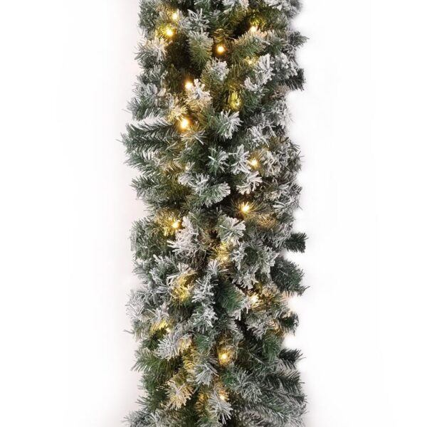A pre-lit Norway Spruce flocked garland. The lights are warm white. The flocked coating gives the garland a snow dusted look
