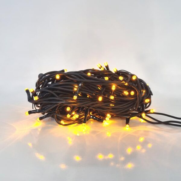 A neat bundle of low voltage LED string lights. The LEDs are amber in colour and the cable is black.