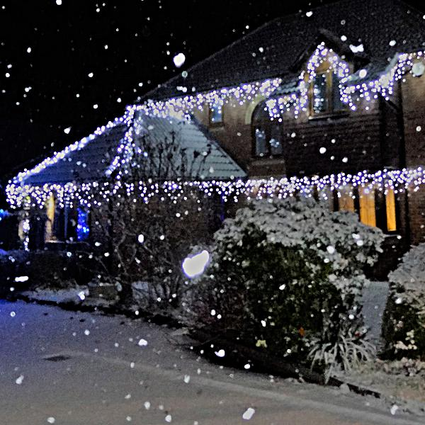 Ice White Icicle Lights on House
